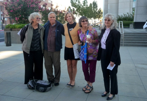 Defendants Jan and David Hartsough, Shirley Osgood, and Sharon Delgado with Cindy Sheehan before trial.