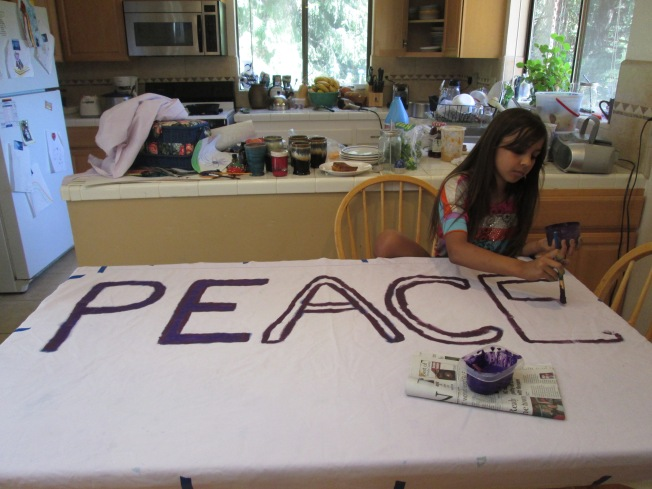Granddaughter Malina working on a banner for peace